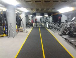 Wet poured sports flooring made from grey and black EPDM in a private gym in Glyfada, Athens.