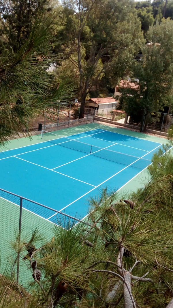 Tennis court renovation using acrylic resins in Attica, Greece